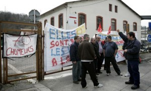 Protesting workers at the Scapa factory in France. Photograph: Laurent Cipriana/AP